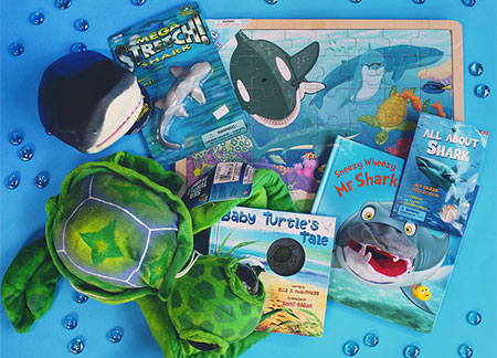 stuffed animal sharks and killer whale painting
